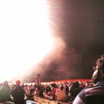 The bright explosion of fireworks is seen by onlookers.