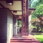 A Frank Lloyd Wright house is seen from the side entrance.