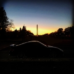 The silhouette of a Porsche 911 in front of The Washington Monument at dusk on The Mall.