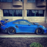A blue Porsche GT2 RS parked.