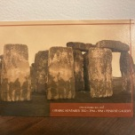 A postcard with a picture of Stonehenge in brown tones.